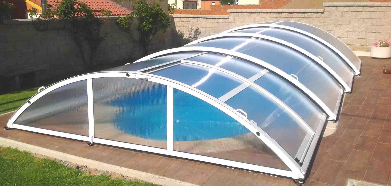 Cubierta para piscina baja telesc pica cubricover for Piscina cubierta tomares
